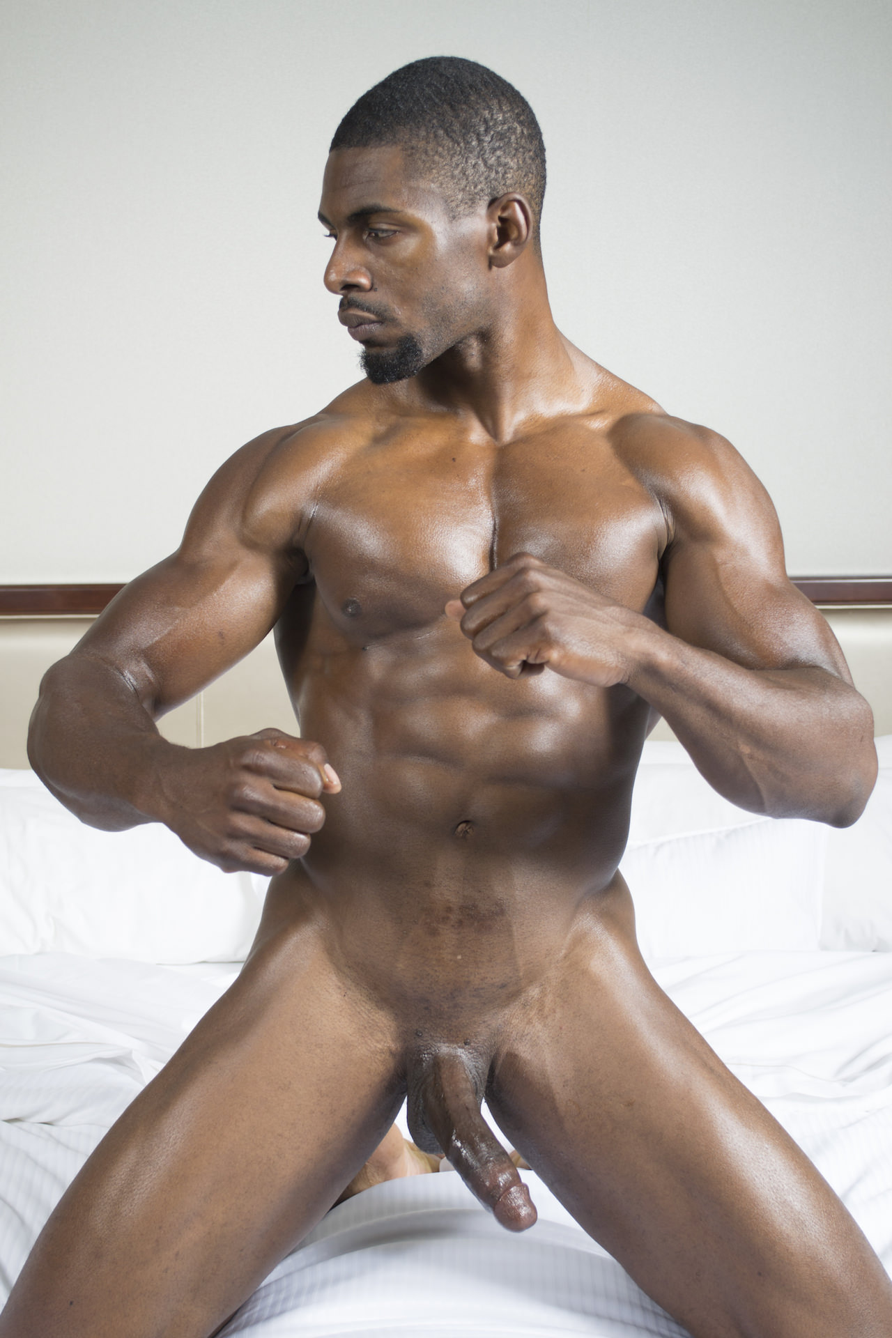 image Muscular black hunk squirts his seed
